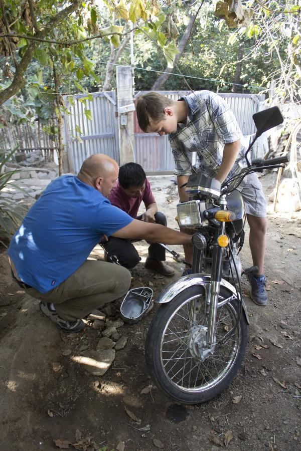 Working on Guatemalan motorycle